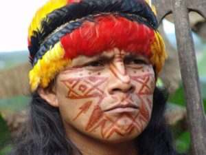 Portrait of Shuar Indian in Ecuador's Amazon, where gross violations of human and environmental rights have been committed by oil companies. Photo: hartman via Flickr (CC BY-NC-SA).