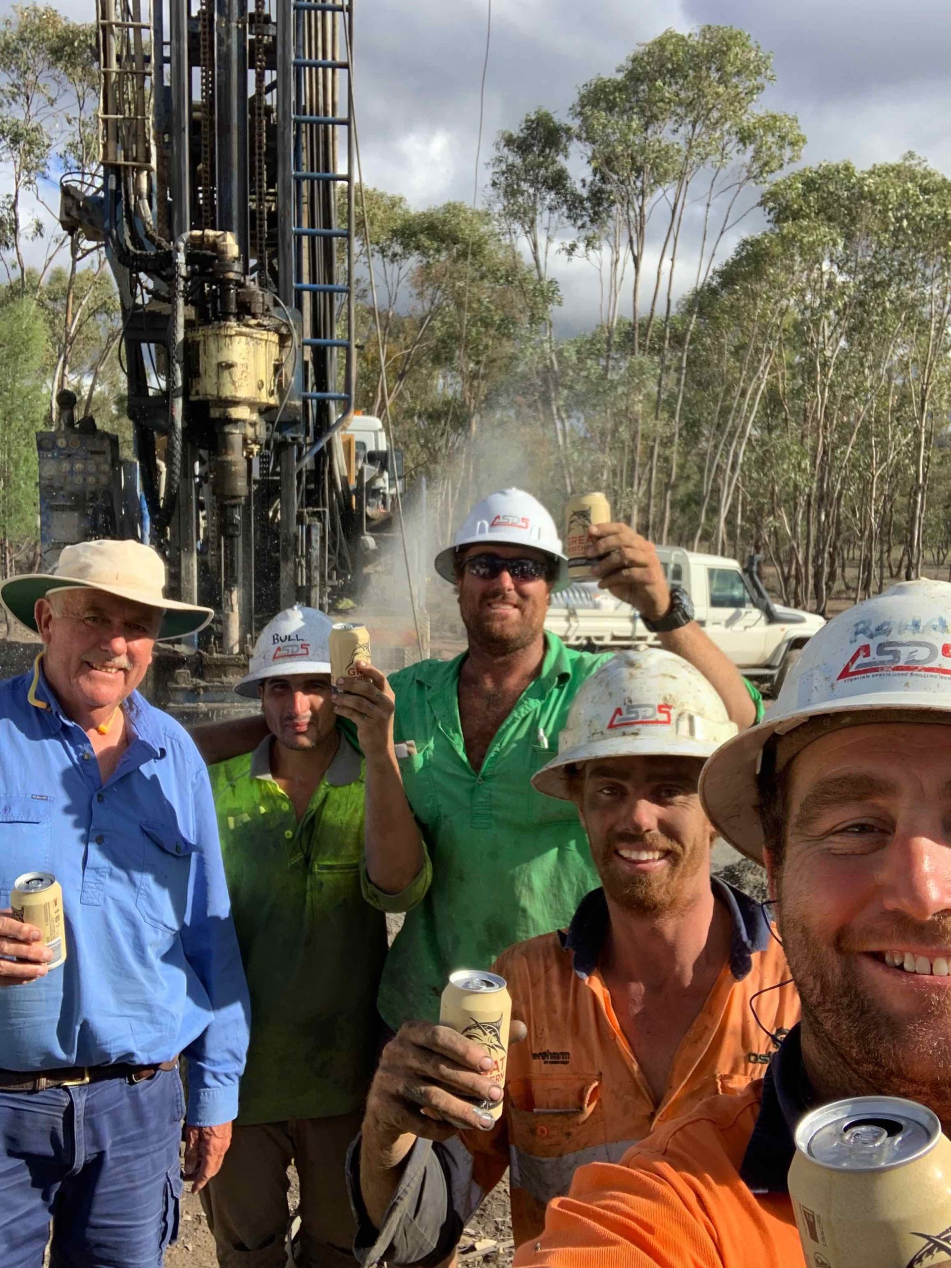 Happy Farmer and water drillers- we hit water!