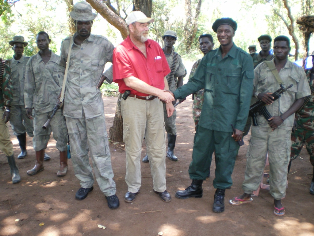 LRA Militia shaking hands w Lawrence Anthony